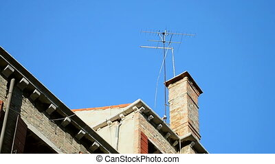earthquake, antenna on the building on blue sky, stress...
