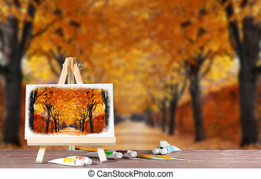 Easel with a watercolor painting of the autumn alley. Abstract image with place for text.