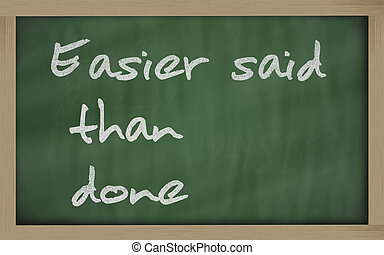 """ Easier said than done "" written on a blackboard"