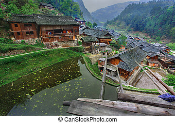 Langde Village, Guizhou, China - April 16, 2010: East asia, rural South West China, the countryside, the village of Miao ethnic minority in the mountainous region, the season spring.