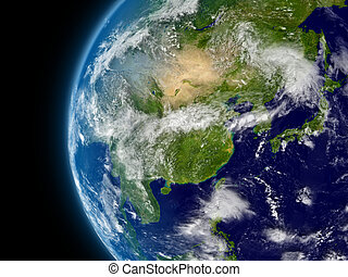 East Asia viewed from space with atmosphere and clouds. Elements of this image furnished by NASA.