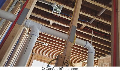 East Brunswick NJ US. 02 MAY 2020: Under construction new home PVC waste water system rough plumbing drainage pipe and fitting complete