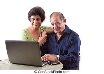 East Indian Elderly Couple on Computer