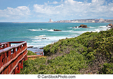east london - East London town, South Africa, coastal line,...