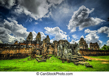 The East Mebon is a 10th Century temple at Angkor, Cambodia. Built during the reign of King Rajendravarman, it stands on what was an artificial island at the center of the now dry East Baray reservoir