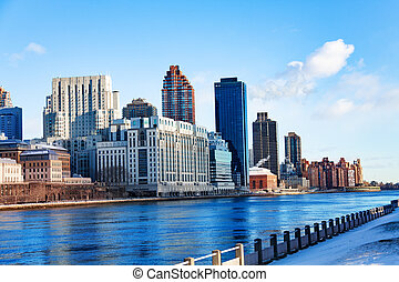 East river from Roosevelt Island and New York view