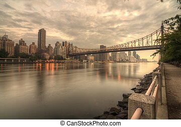 East River - Queensboro Bridge Spanning the East River in...