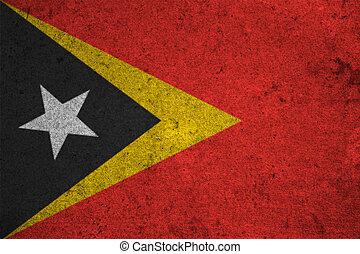 east timor flag on an old grunge background