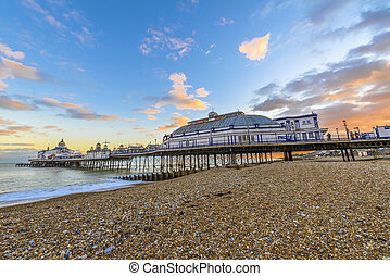 Eastbourne Pier and beach at sunset, East Sussex, England, UK