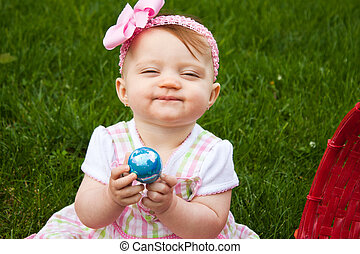 Easter Baby Hold Egg Smirk
