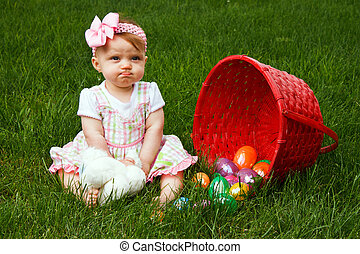 Easter Baby Spill Pout - Baby girl frowning beside a spilled...