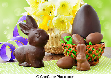 Easter background, chocolate eggs in basket, chocolate bunnies