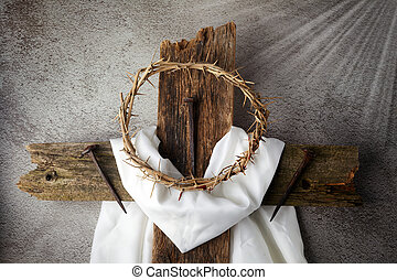 Easter background depicting the crucifixion with a rustic wooden cross, crown of thorns and nails.
