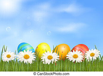 Easter background Easter eggs laying in green grass with...