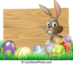 Easter background sign - The Easter bunny with a basket of...