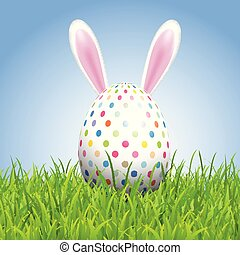 Easter background with bunny ears and egg in grass