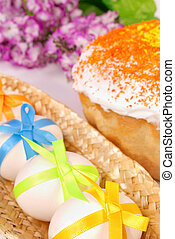 Easter background with cake and eggs decorated with bows