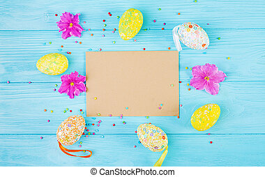 Easter background with flowers and easter eggs. Top view