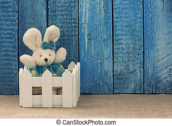 Easter background with toy rabbit