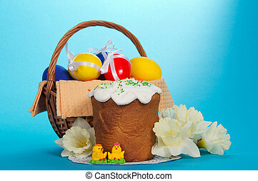 Easter basket and flowers - Eggs in a basket, an Easter...