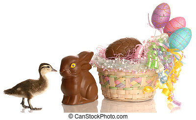 easter basket filled with eggs and chocolate bunny with baby duck