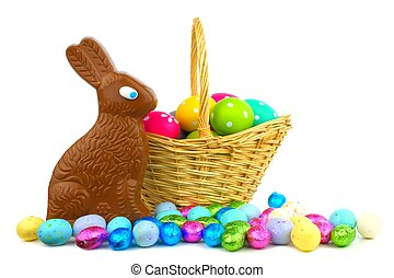 Easter basket of candy - Chocolate bunny and candy with...