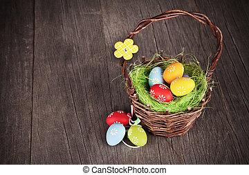 Easter basket on wooden table