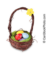 Easter basket with colored eggs, isolated on white...