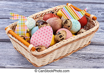 Easter basket with paper cutouts.