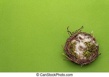Easter bird nest. Zero waste, DIY concept. Soft feathers, moss. Green background