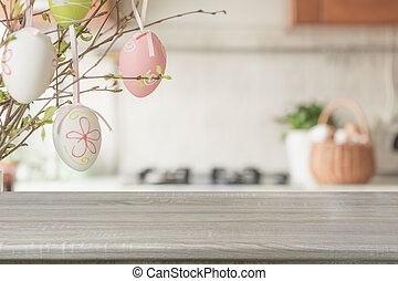 Wooden tabletop with empty space for display your product. Blurred abstract kitchen background. Easter party holiday.