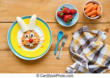 Easter breakfast for kids. Easter bunny shaped pancake with fruits