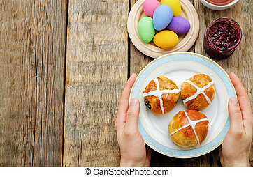 Easter Breakfast. Man holding the plate with the buns with a...