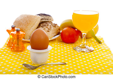 Easter breakfast with egg, bread, fruits and drinks