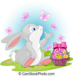 Easter Bunny - A cute Easter bunny sitting near Easter eggs ...