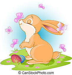 Easter Bunny - A cute Easter bunny standing near brightly...