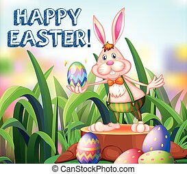 Easter bunny and decorated eggs in the garden