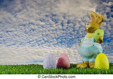 Easter bunny and eggs in the aky