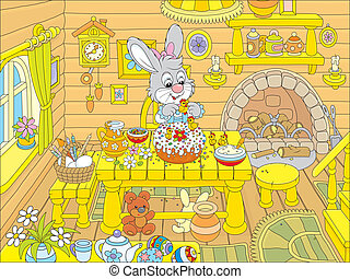Little rabbit decorating a fancy Easter cake in the kitchen