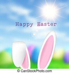 Easter bunny ears on a defocussed sunny landscape background