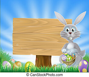 Easter bunny eggs and wooden sign