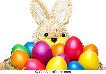 Easter bunny has basket full of colourful easter eggs -...