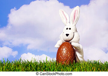 Easter bunny holding a chocolate egg