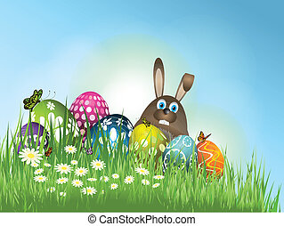 Easter bunny in grass with eggs