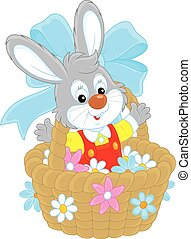 Easter Bunny - Little rabbit sitting in a basket with...