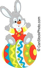 Easter Bunny - Little rabbit sitting on a big decorated...