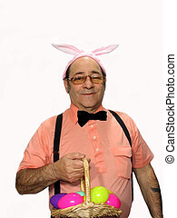 Easter Bunny - Man as the Easter bunny holding a basket of...
