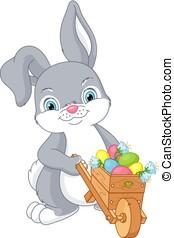 Easter Bunny - Rabbit wheeling a wheelbarrow with Easter...
