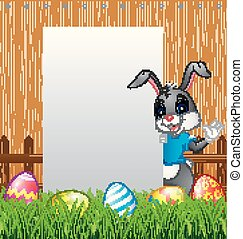 Easter bunny waving hand with blank sign