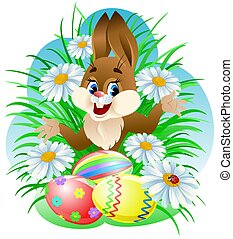 Easter bunny with colorful eggs in grass